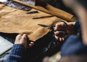 Man cutting Leather